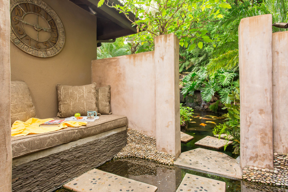 Inspiration for a large asian partial sun backyard concrete paver pond in Los Angeles.