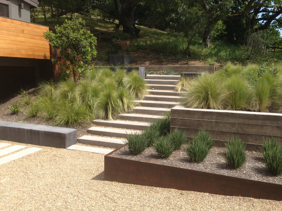 Inspiration for a large modern drought-tolerant and full sun hillside gravel retaining wall landscape in San Francisco.