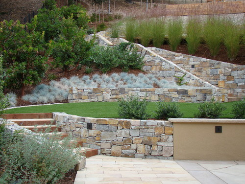 landscaping ideas for hillside backyard slope solutions  install, tiered backyard landscaping ideas