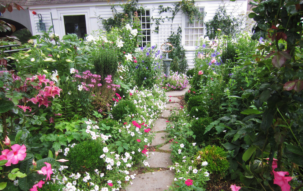 Inspiration for a traditional backyard stone landscaping in Boston.
