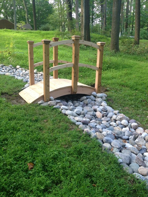 Landscaping and river rock drainage swale traditional for Landscape drainage design