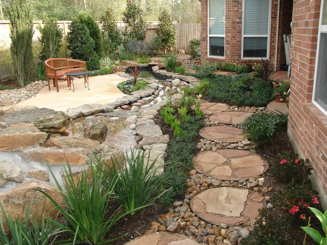 Landscaping with oversize pavers and backyard creek hkns for Garden design houston