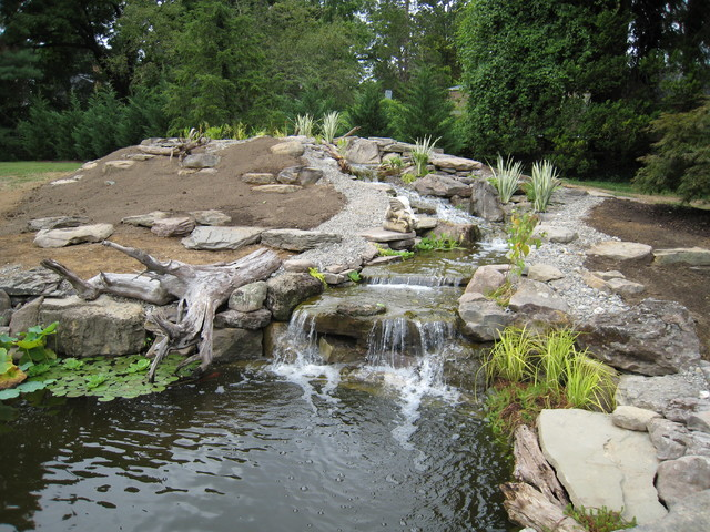 Large pond start to finish traditional-landscape