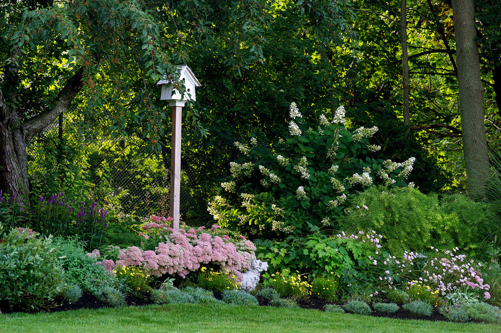 This is an example of a traditional backyard landscaping in Boston for summer.