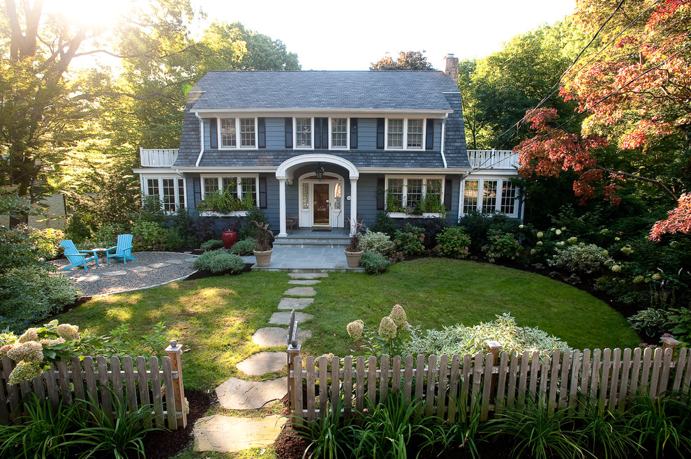 Photo of a mid-sized traditional full sun front yard stone landscaping in New York.