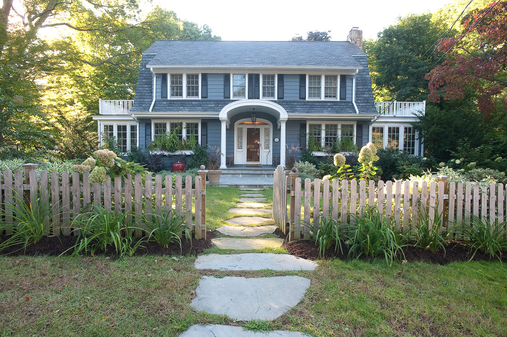 Inspiration for a traditional shade front yard stone landscaping in New York.