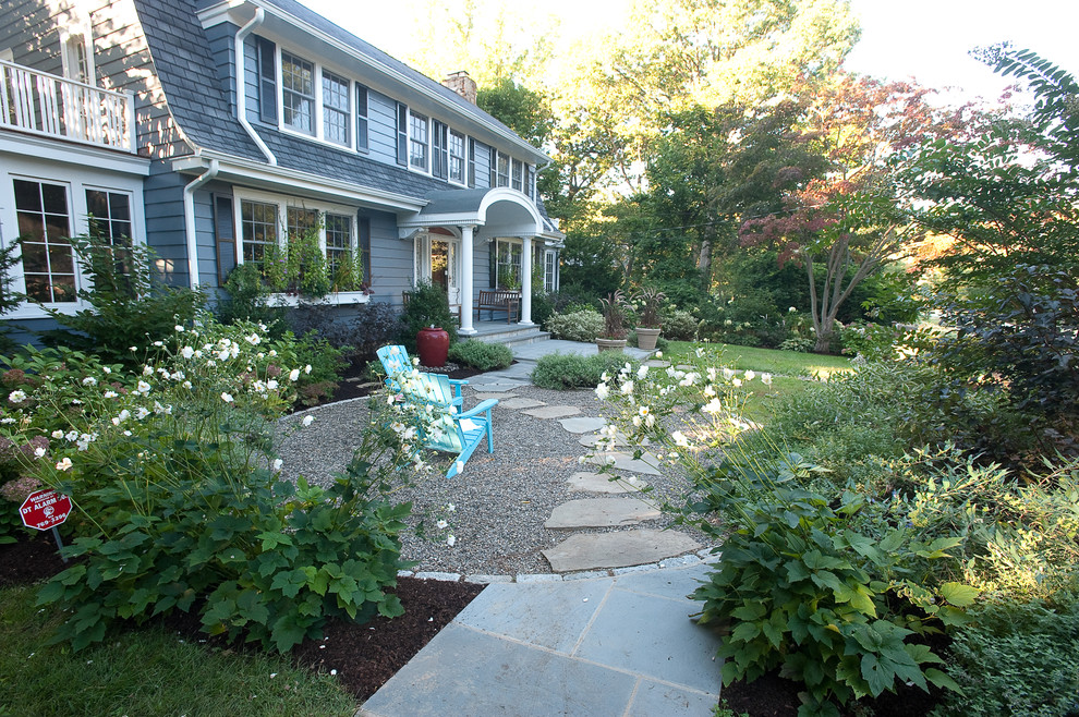 Design ideas for a traditional shade backyard gravel landscaping in New York.