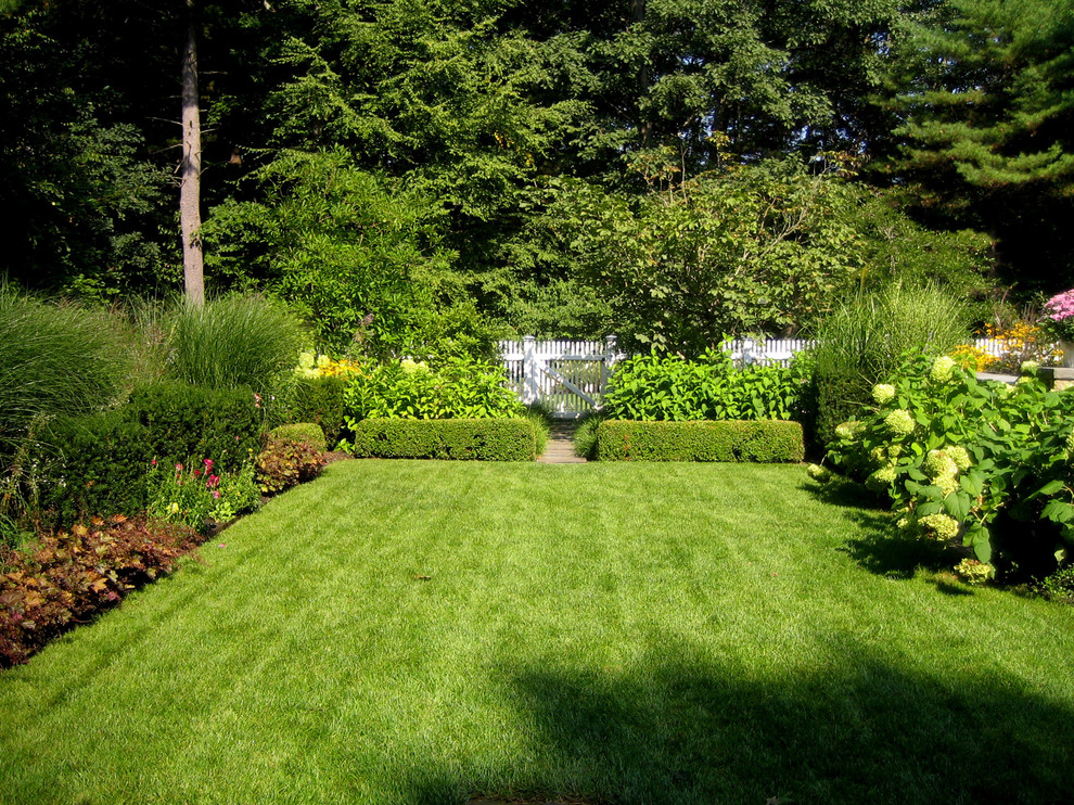 Photo of a traditional backyard landscaping in Boston.