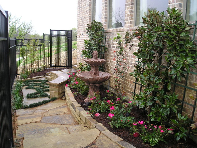 photo of a mid sized traditional partial sun side yard stone landscaping in dallas for - Little Garden