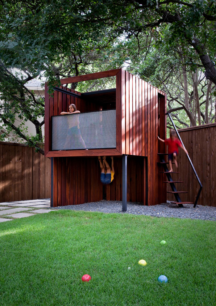 This is an example of a mid-sized contemporary backyard outdoor playset in Austin.