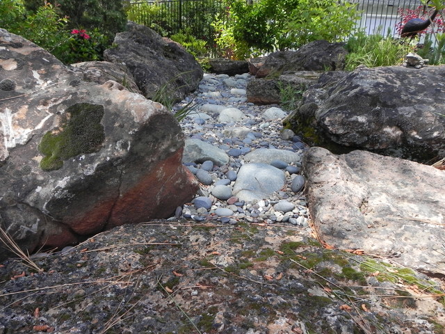 Creek bed with boulders rustic landscape sacramento for Landscaping rocks sacramento