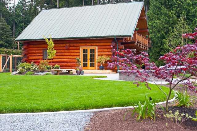 Log cabin by lake rustic landscape seattle by for Rustic landscape ideas