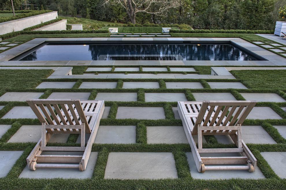 Photo of a huge contemporary full sun backyard stone formal garden in San Francisco.