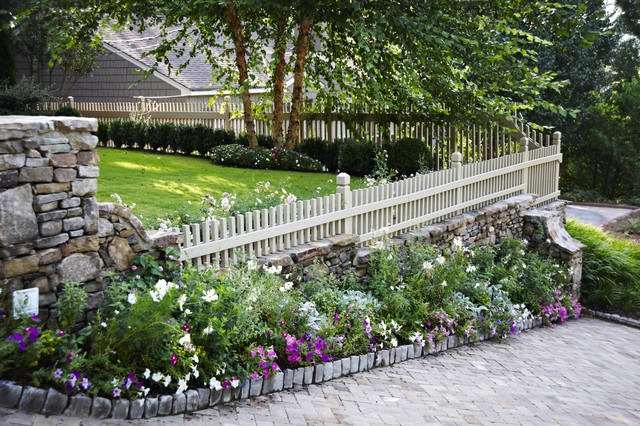 Landscaping A Sloping Driveway : Low fence on stone wall traditional landscape atlanta by troy rhone garden design