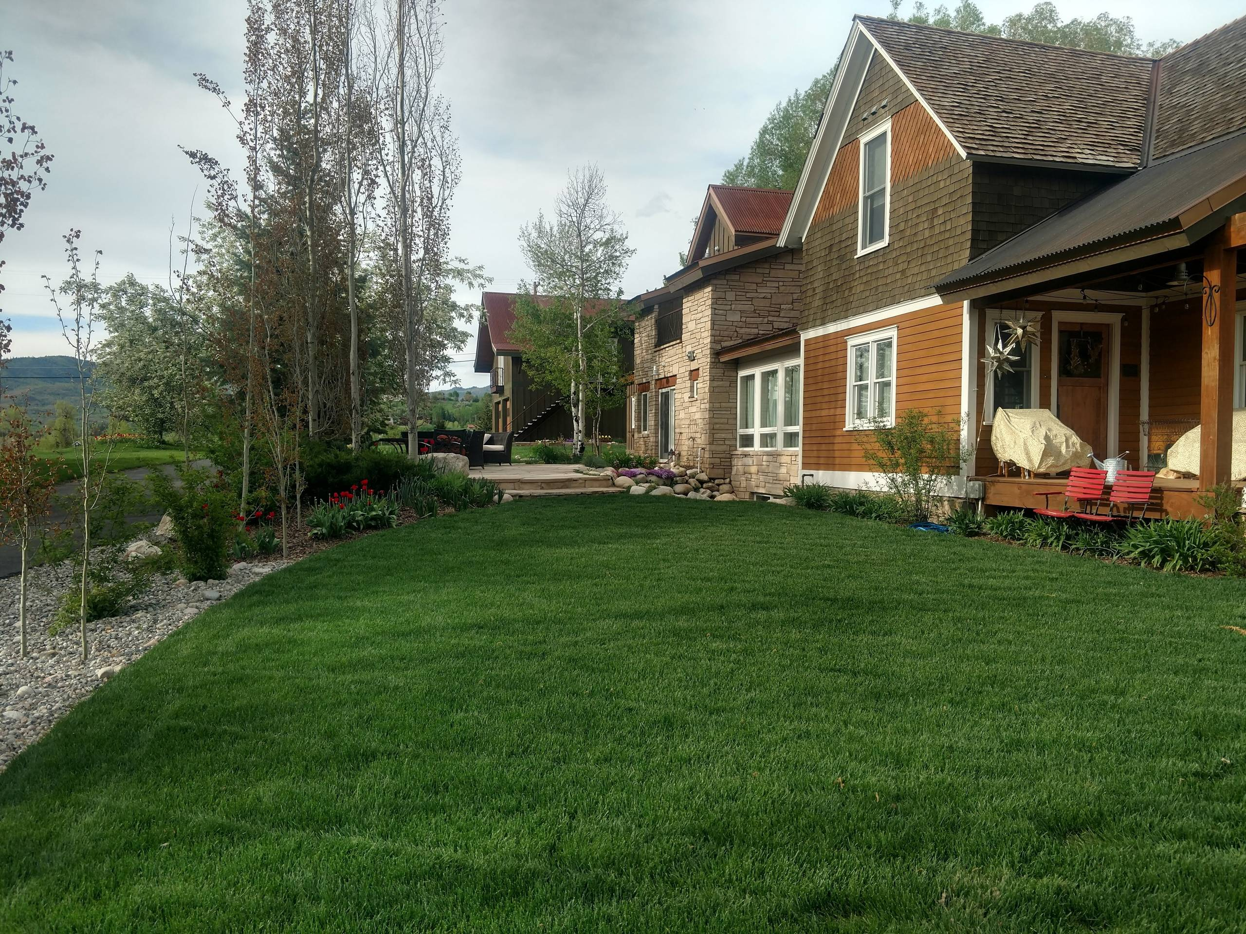Major redo of a landscape for a quaint home in Steamboatfront yard after one yea