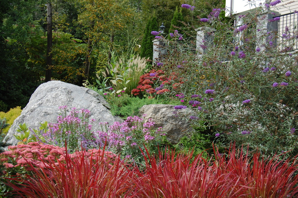 Inspiration for an eclectic hillside landscaping in New York.