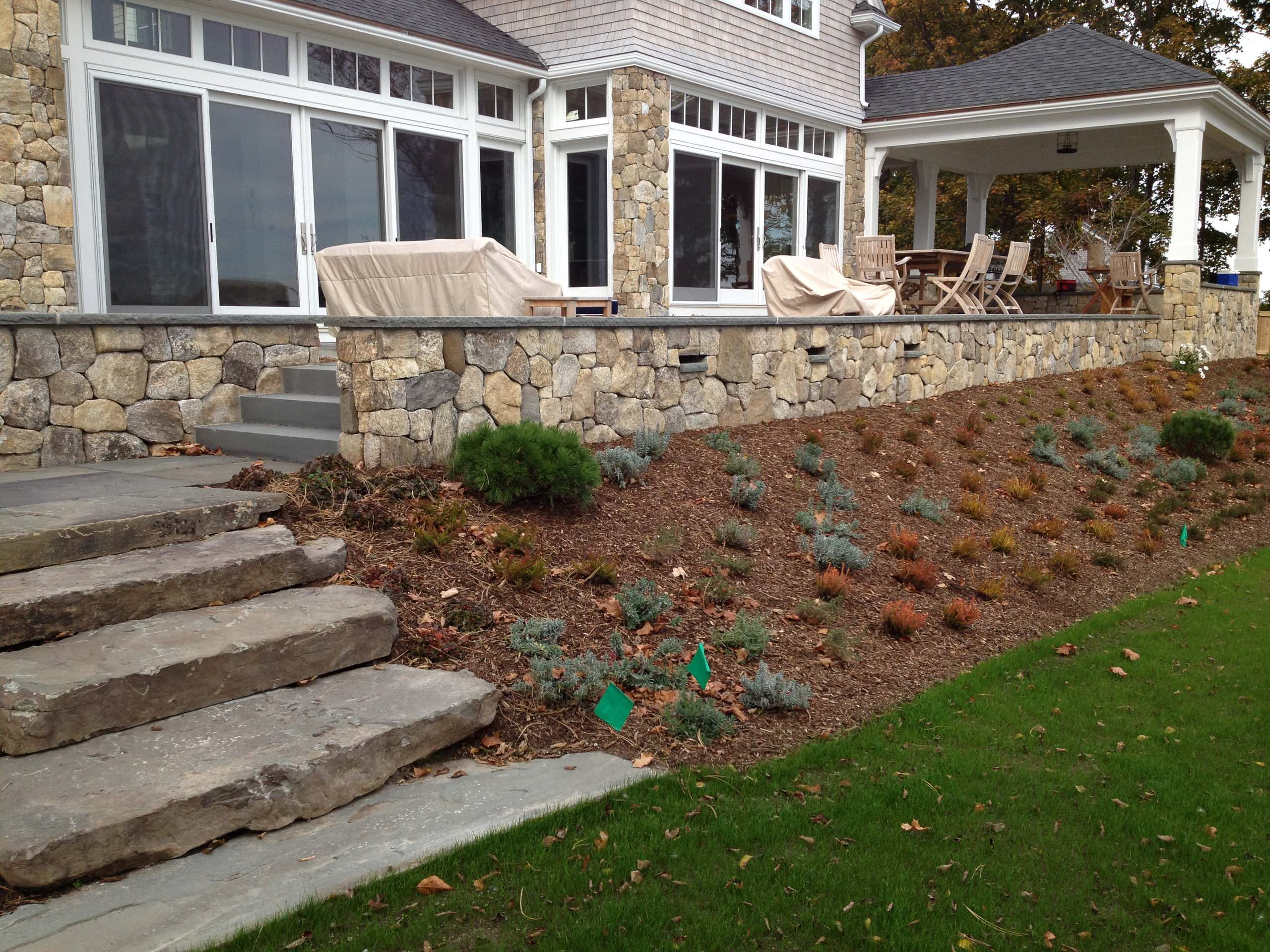 Massive stone steps lead from lawn to bluestone landing