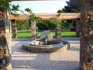GARDEN: meditation garden with reclaimed olive press fountain