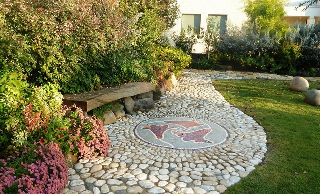 Artist made mosaic integrate in a pebbles made path