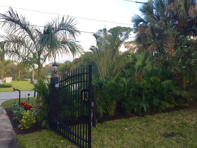Melbourne beach front gate landscape planting tropical for Landscape contractors melbourne