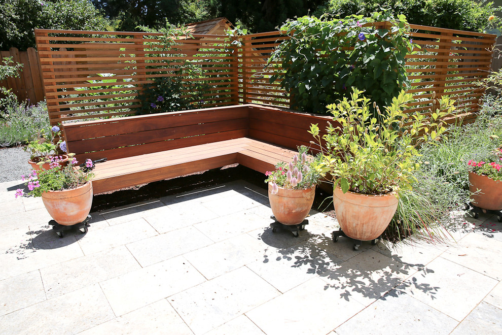 This is an example of a mid-sized transitional full sun backyard stone water fountain landscape in San Francisco for spring.