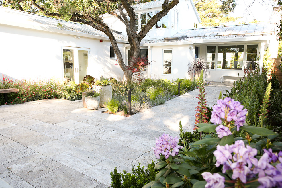 This is an example of a mid-sized transitional partial sun backyard stone landscaping in San Francisco for spring.