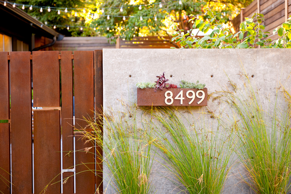 Inspiration for a small mid-century modern partial sun front yard stone garden path in Seattle.