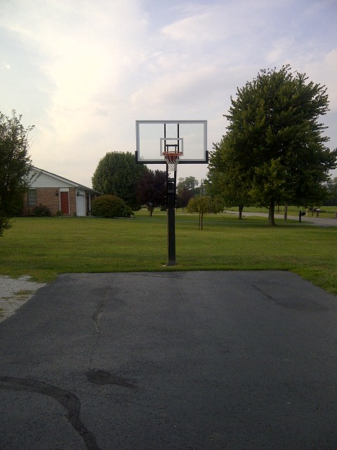 Mike K's Pro Dunk Diamond Basketball System on a 21x42 in Sugarland, TX traditional-landscape