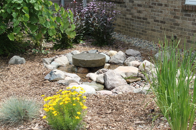 mill stone water feature in ann arbor mi landscape