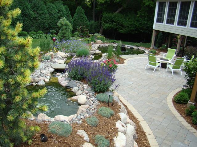 Minnesot backyard, perennials, water feature, fire pit  Traditional