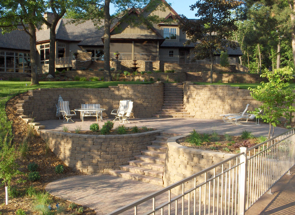 Photo of a traditional hillside stone landscaping in Minneapolis.
