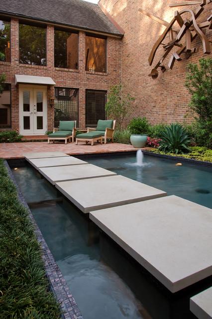 Modern koi pond contemporary garden houston by for Modern fish pond design