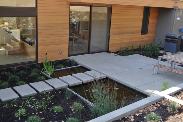 Outdoor deck and water feature japanese room native home for Concrete koi pond design