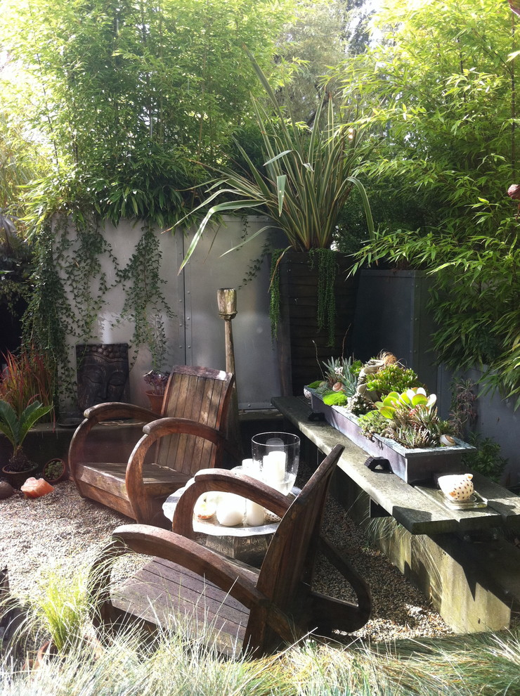 Design ideas for a tropical backyard landscaping in Vancouver.