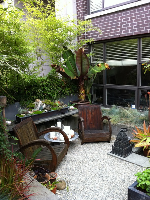 Modern tropical courtyard tropical landscape for Landscaping rocks vancouver