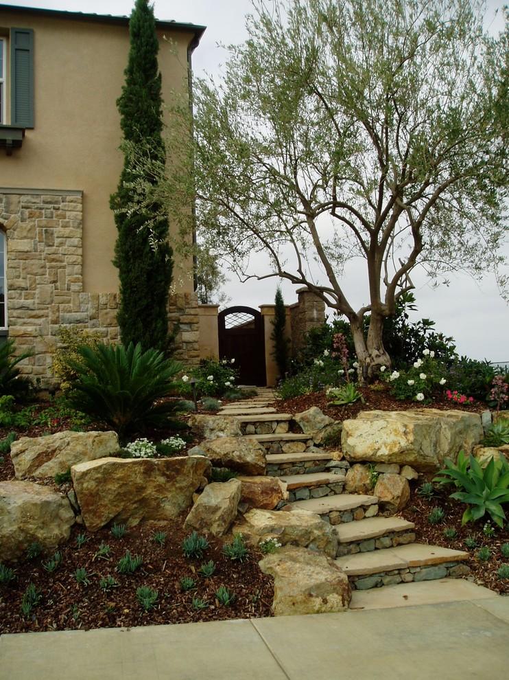 Design ideas for a mediterranean hillside stone landscaping in San Diego.