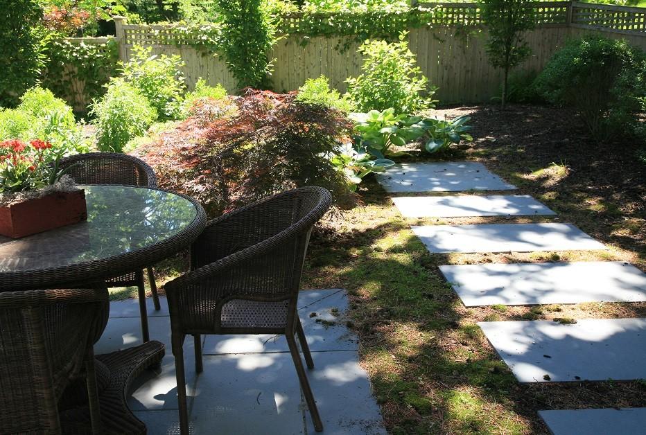 Moss floor meets bluestone paving. Last bluestone slab awaits sculpture piece.