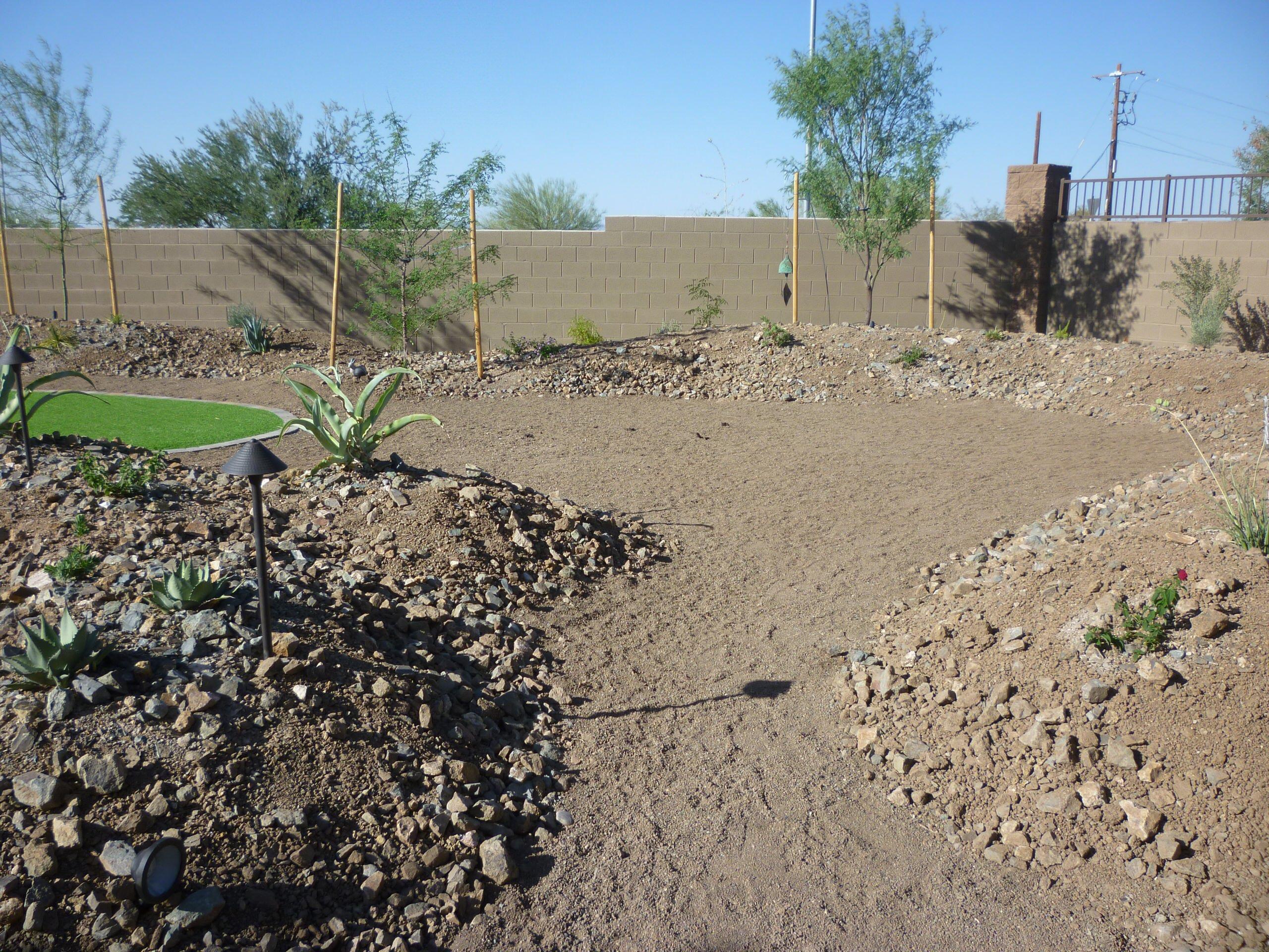 Mounding w/ Rock & Plantings