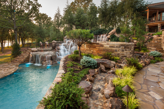 Mountain mine themed pool with waterfalls slide and more for Mountain landscape design