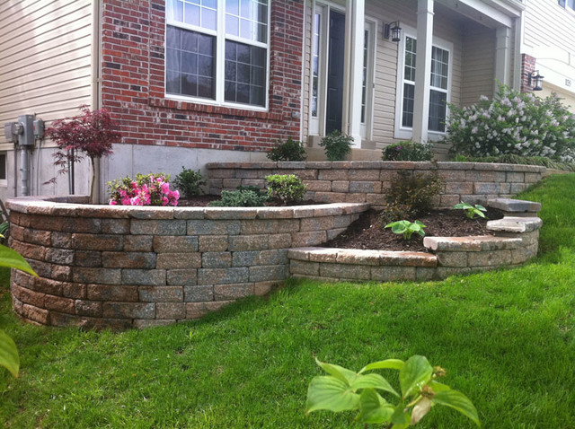 Multi tiered retaining wall traditional landscape st for Tiered garden designs