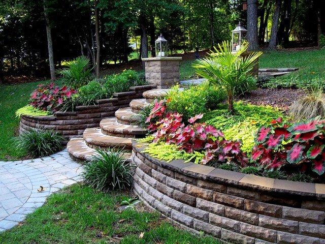 Multiple projects traditional landscape raleigh by - Garden ideas sloped backyards ...