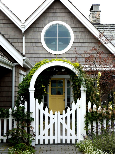 Inspiration for a victorian front yard stone landscaping in Seattle.