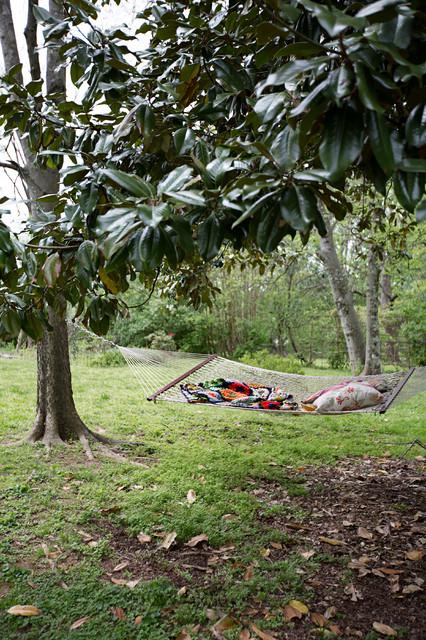Design ideas for an eclectic partial sun backyard landscaping in Nashville for summer.