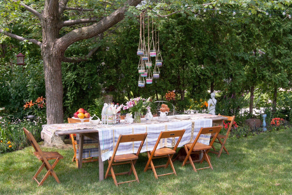 Inspiration for a large shabby-chic style shade side yard landscaping in Cleveland for summer.