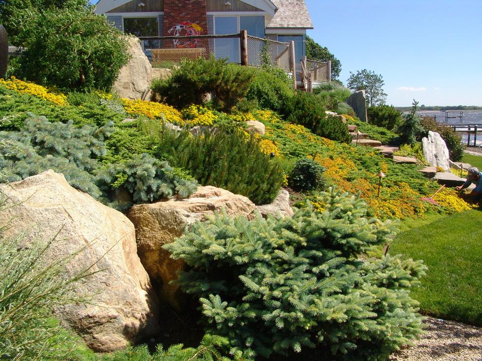 Design ideas for a large asian full sun hillside stone garden path in Providence for summer.