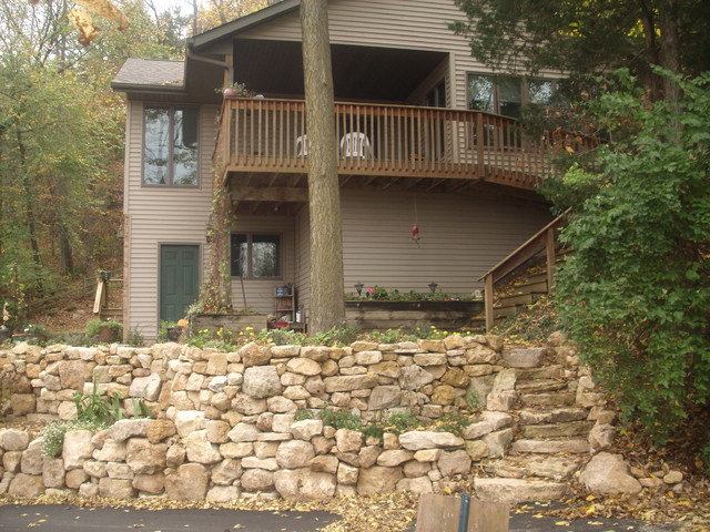 Natural Limestone Walls : Natural limestone boulder retaining wall with built in