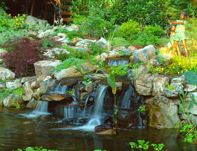 Natural looking waterfalls traditional landscape for Tiered pond waterfall