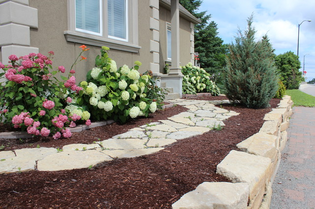 Landscaping With Mulch And Stone : Natural stone path and wall with brown mulch garden