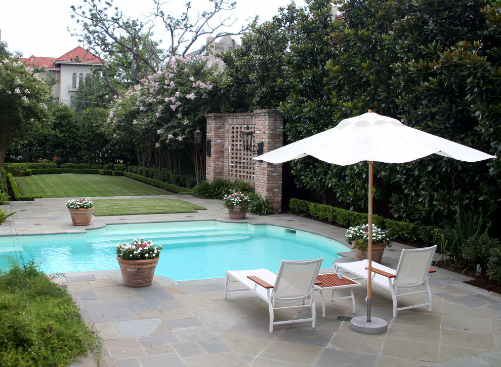 This is an example of a traditional backyard stone landscaping in New Orleans.