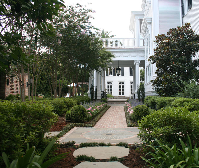 Inspiration for a traditional front yard brick formal garden in New Orleans. - New Orleans Estate